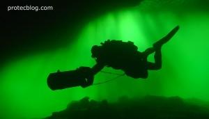 cave diver entering cenote Chak Mool