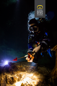 Cave Diver Installing Line Arrow - Credit Global Dive Guide